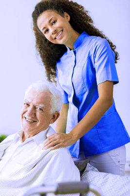 Young Black Female Caregiver Elderly White Man